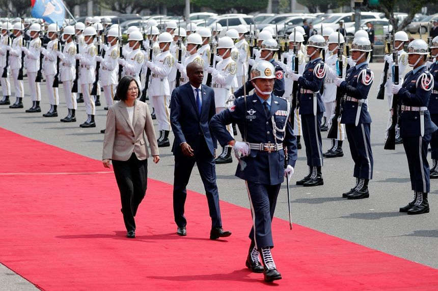 Taiwan's President Tsai Ing-wen and her counterpart from Haiti, Jovenel Moise, reviewing an honour guard at a welcoming ceremony, in Taipei, Taiwan, on May 29, 2018.