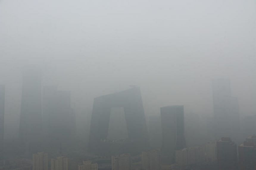 Buildings are seen amid thick smog on a polluted day in Beijing, China, on April 2, 2018.