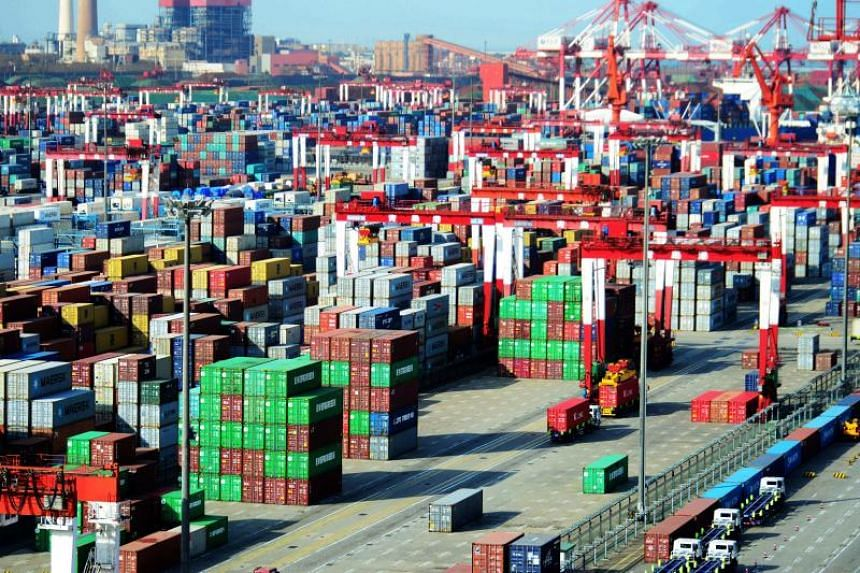 Shipping containers are seen at a port in Qingdao, China, on April 13, 2018.