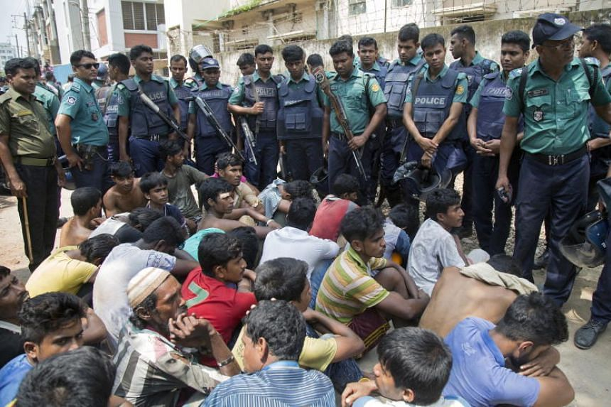 Dhaka Metropolitan Police personnel arrest several people for allegedly taking and selling drugs during an anti-narcotics operation in Dhaka on May 28, 2018.