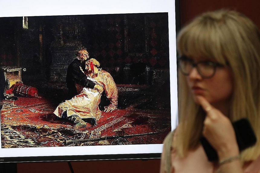 The screen of a monitor showing the damaged painting, Ivan The Terrible And His Son Ivan, by Russian artist Ilya Repin at the State Tretyakov Gallery in Moscow.