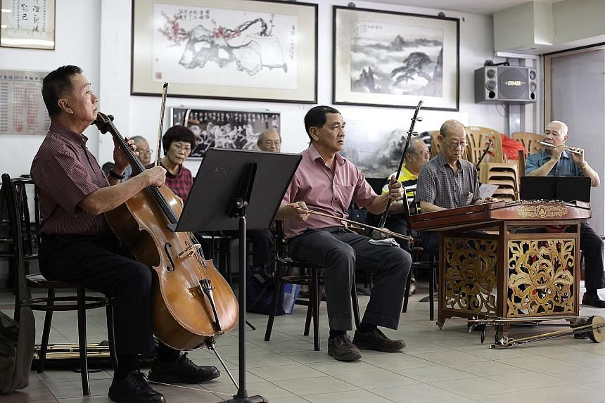 Some members of the Thau Yong amateur musical association (from left): Mr Tan Gee Seng, 67, on the cello; Mr Chow Kok Yong on the tihu; Mr Yeo Eiong Lok, 76, on the yangqin;, and Mr Sim Song En, 80, on the dizi at Kityang Huay Kwan's headquarters. Mr