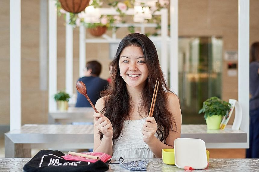 Undergraduate Rachel Tan carries with her reusable items such as wooden chopsticks and spoon, a bamboo straw and lunch box to show that she walks the talk when it comes to not using disposables.