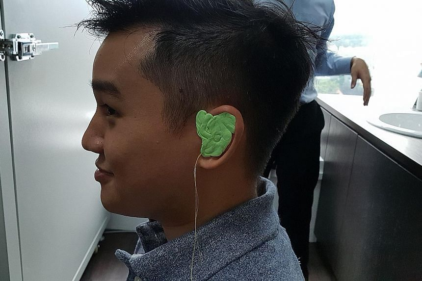 The first step to getting a pair of custom in-ear monitors requires users to get a mould of their ears, which involves injecting putty (above) into the ears (left).