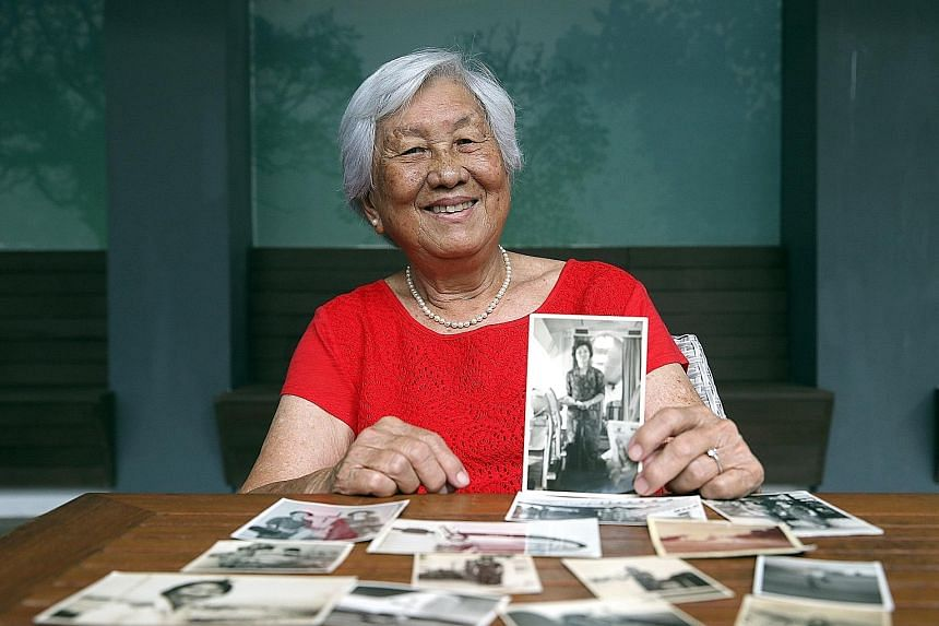 Madam Lye wore a special kebaya with gold details when the crew served the Sultan of Brunei on a flight in 1964. Madam Susan Lye holding a photo of her days as an air stewardess with the former Malayan Airways, which was later rebranded as Malaysia-S