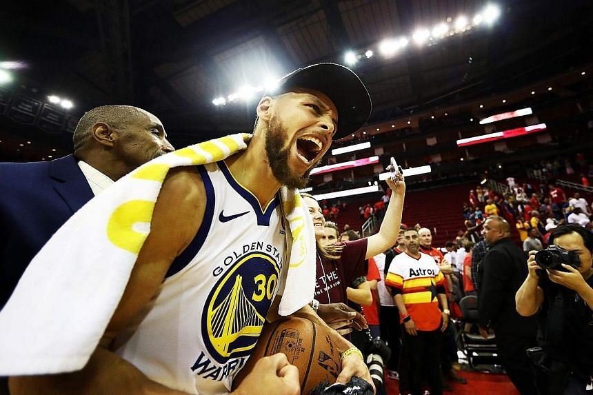 Stephen Curry scored 14 of his 27 points in the crucial third quarter, sparking a dramatic revival as Golden State beat the Houston Rockets 101-92 on Monday.