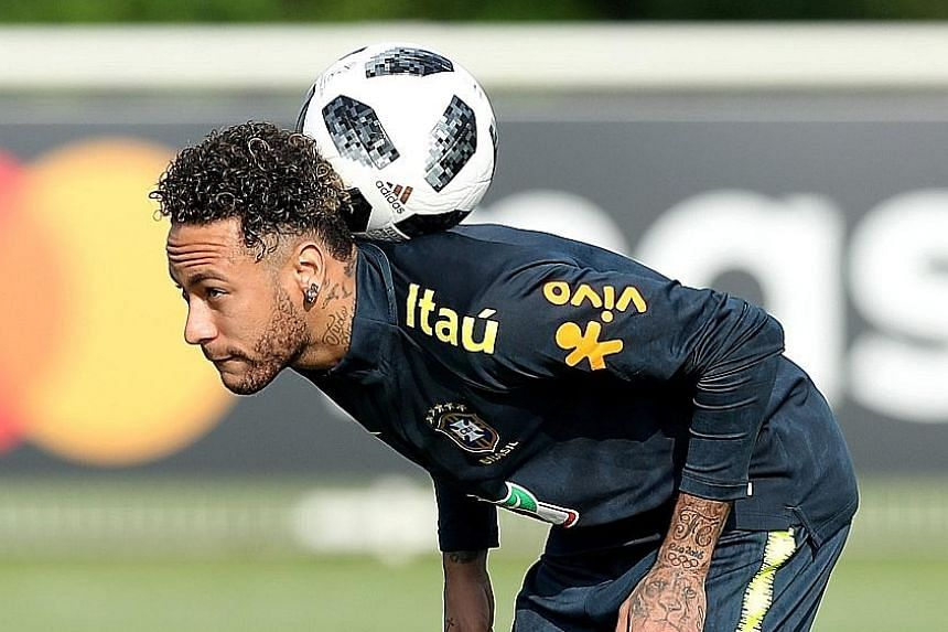 Neymar at a training session in London on Monday. The Brazil star, who suffered a broken metatarsal in February, says he is working on unimpeded movements and that he will be ready for his country's World Cup opener against Switzerland on June 17.