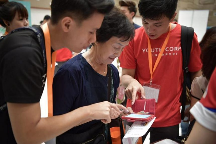 Participants at the e-Payment Learning Journey programme were first taught how to find and download the relevant apps on their smartphones and how to register and log in to their respective accounts.