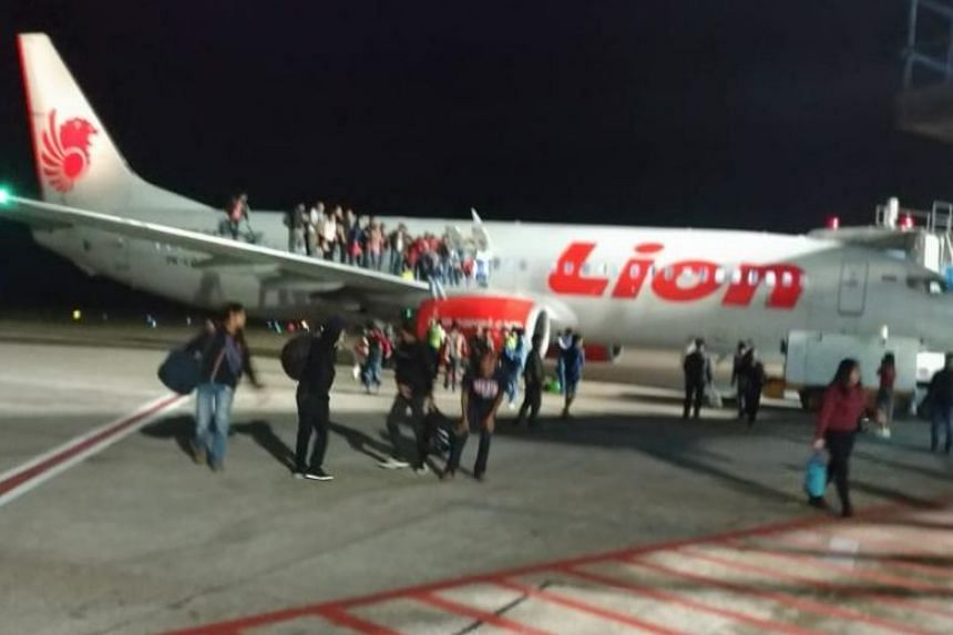 A video recording of the incident, which went viral on social media in Indonesia, showed panicked passengers jumping out through the emergency door as well from the plane's wings, causing them suffer injuries.