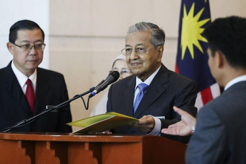 Malaysian Prime Minister Mahathir Mohamad (centre) at a press conference in Putrajaya, Malaysia, on May 30, 2018.