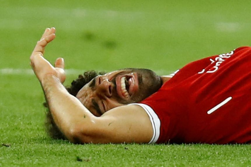 """Club physio Ruben Pons has estimated Mohamed Salah would normally need """"three to four weeks"""" to recover from the left shoulder injury he sustained during the Champions League final against Real Madrid."""