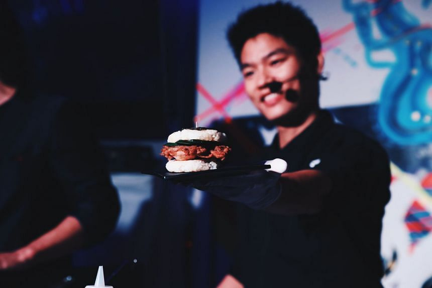 Japanese chef Shoichi Ueda with a har cheong kai rice burger at Tiger Beer's launch event in Tokyo.