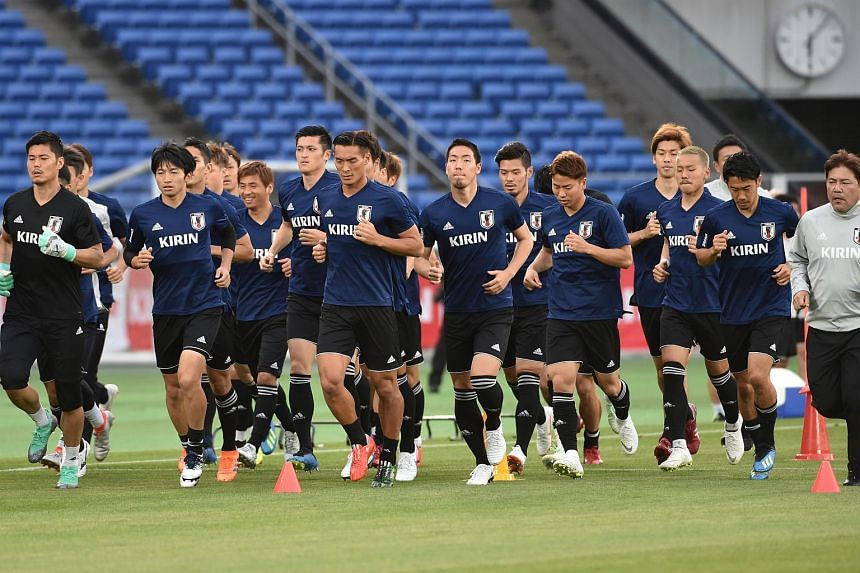 Japan's national football team warm up during a training session in Yokohama, on May 29, 2018, ahead of an international friendly match with Ghana.
