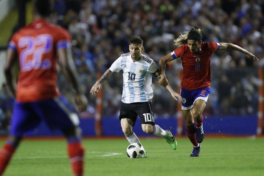 Argentina's Lionel Messi (centre) vies for a ball with Zachary Herivaux of Haiti during a friendly match at La Bombonera stadium in Buenos Aires, Argentina, on May 29, 2018.