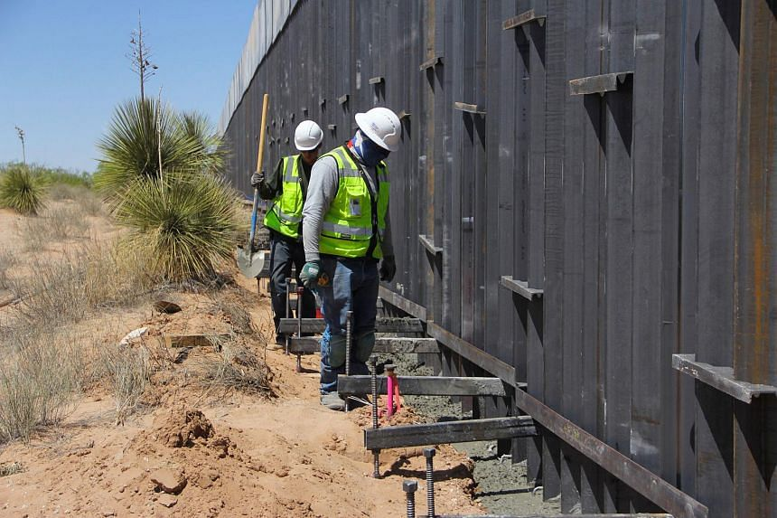 Workers replace an old section of the wall between the US and Mexico. US President Donald Trump repeated his campaign promise that Mexico will pay for building a wall along the US-Mexico border.