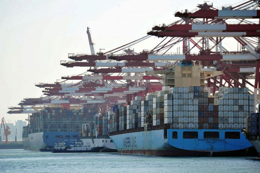 Cargo containers loaded on container ships at a port in Qingdao in China's eastern Shandong province, on April 8, 2018.