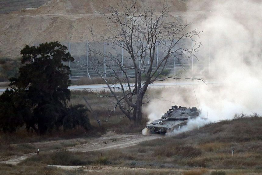 An Israeli army tank patrols along the border between Israel and the Gaza Strip, on May 29, 2018. Israel's military said it struck dozens of militant targets in the Gaza Strip in response to rocket and mortar fire.