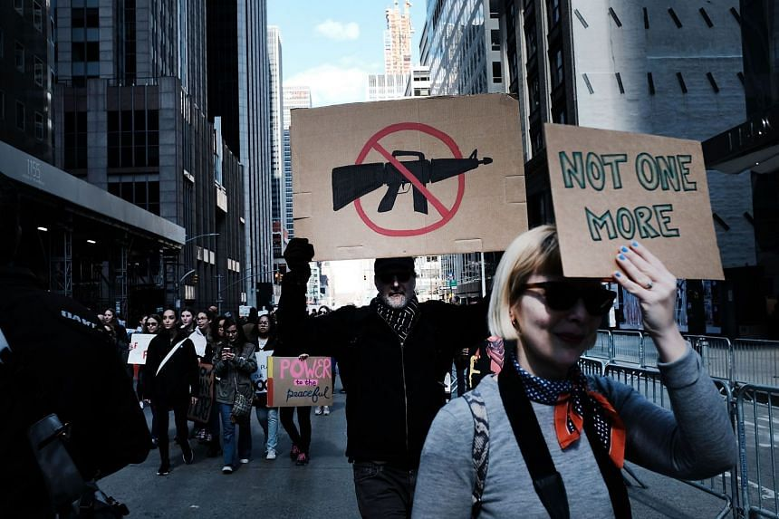 People marching against gun violence in Manhattan, on March 24, 2018, during the March for Our Lives rally organised by survivors of the Parkland shooting.
