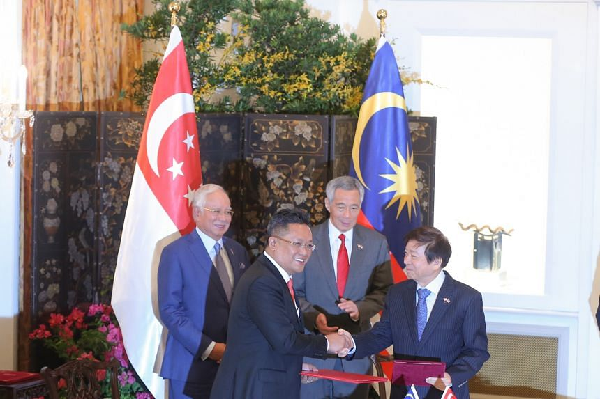 Malaysia's then Minister in the Prime Minister's Department Abdul Rahman Dahlan (left) and Singapore's Coordinating Minister for Infrastructure and Transport Minister Khaw Boon Wan at the Istana in January, after signing a pact to build a cross-borde