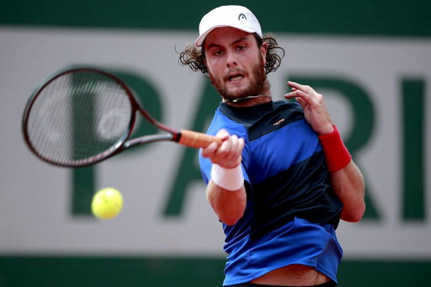 Marco Trungelliti hits a shot against Marco Cecchinato during their men's second round match during the French Open tennis tournament, on May 30, 2018.