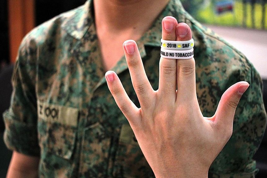 An SAF personnel pledges to abstain from tobacco for 24 hours on World No Tobacco Day. It is part of an initiative under the SAF Smoking Cessation Framework.