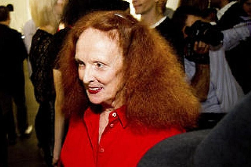 Louis Vuitton designer Nicolas Ghesquiere sent red-haired models down a catwalk at the Maeght Foundation art gallery and gardens in a nod to Grace Coddington's trademark mane.