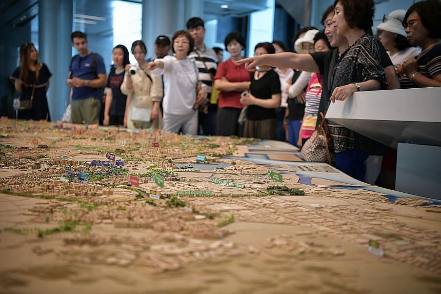 Visitors at the Underground: Singapore's Next Frontier exhibition yesterday. National Development Minister Lawrence Wong, who was at the opening of the exhibition, detailed plans for subterranean development, including that for the new 230kV station
