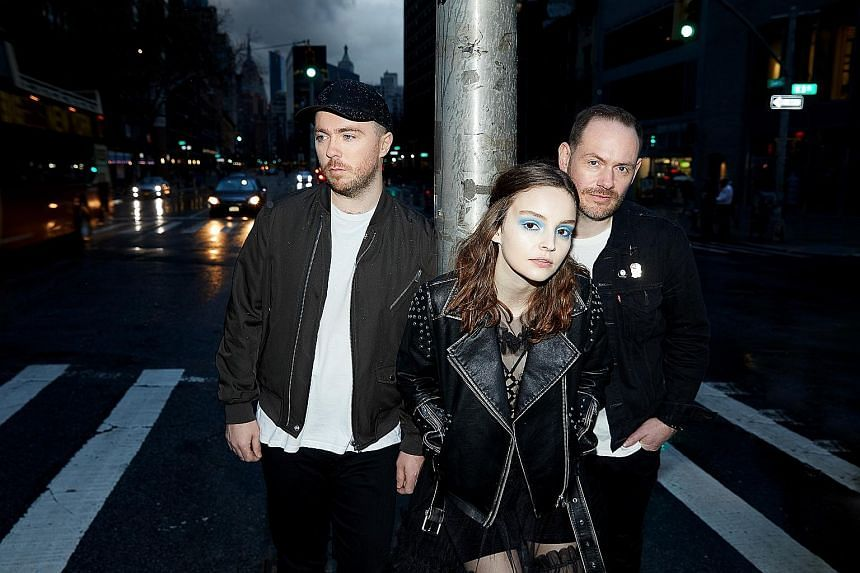 Chvrches' (from far left) Martin Doherty, Lauren Mayberry and Iain Cook go beyond romantic concerns on their third album.