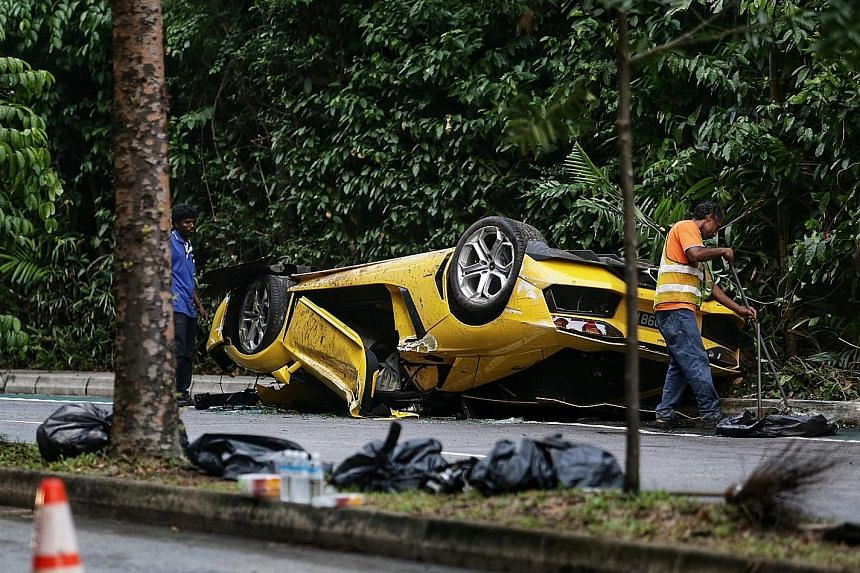 The overturned Lamborghini, with its front bonnet mangled, following the accident.