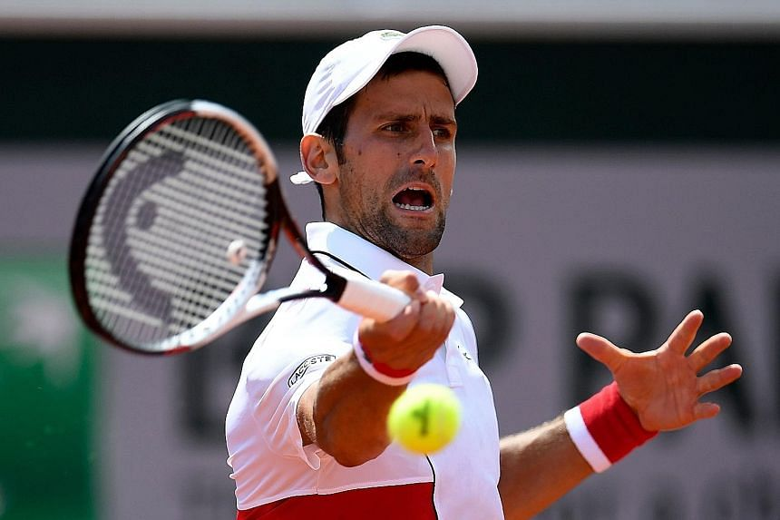 Novak Djokovic hits a forehand during his 7-6 (7-1), 6-4, 6-4 second-round win over Spanish qualifier Jaume Munar at the French Open yesterday. His next opponent will be another Spaniard, Roberto Bautista Agut.