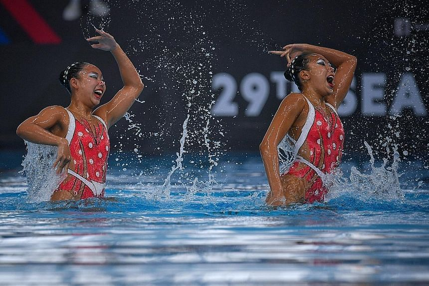 Synchronised swimmers Miya Yong (left) and Debbie Soh performing their gold-winning duet technical routine at last year's SEA Games. Soh and four other members of the 2017 squad are among the eight picked for the Asian Games.