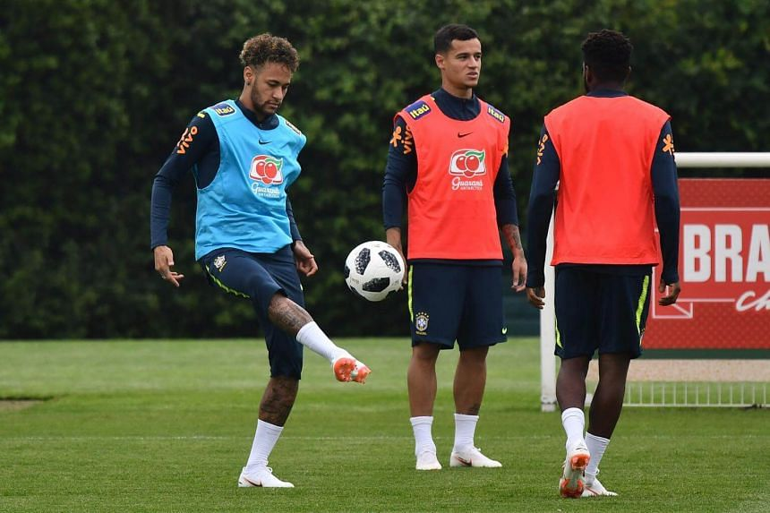 Brazilian striker Neymar (left) and teammate Philippe Coutinho taking part in a training session at Tottenham Hotspur's Enfield Training Centre, on May 30, 2018.