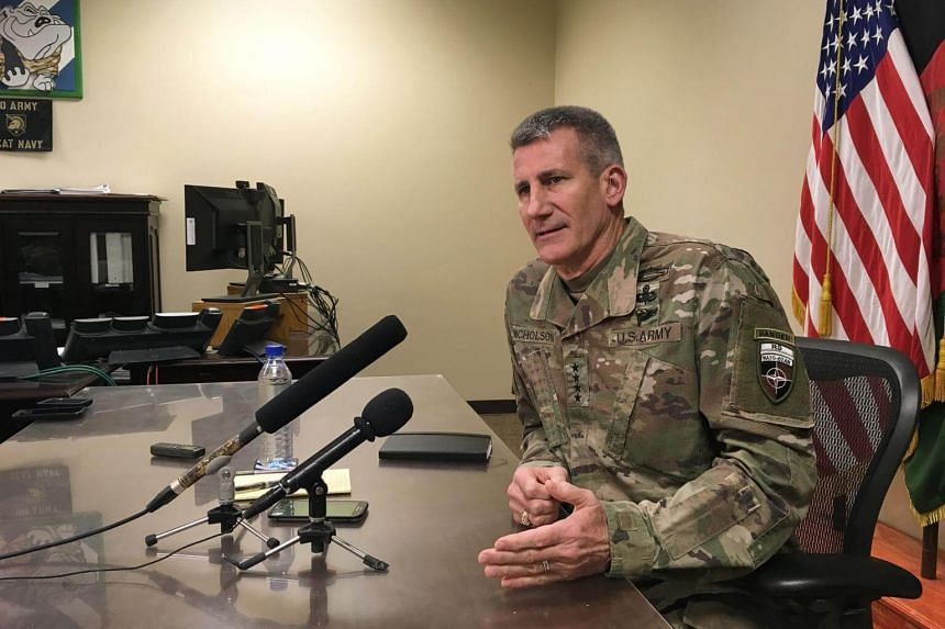 General John Nicholson speaks to reporters at Bagram Air Base, about 60km north of the Afghan capital Kabul, on March 14, 2018.