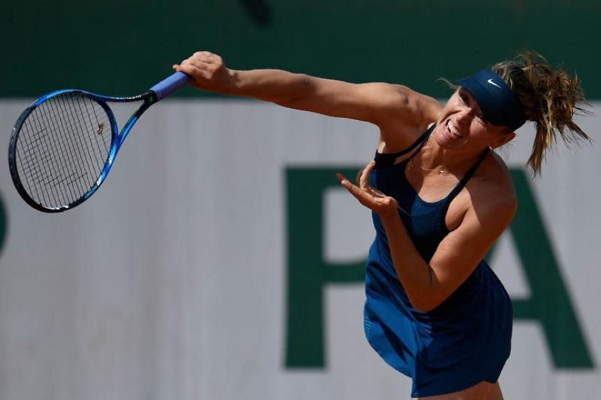 Russia's Maria Sharapova serves to Croatia's Donna Vekic during their women's singles second round match on day five of The Roland Garros 2018 French Open tennis tournament in Paris on May 31, 2018.