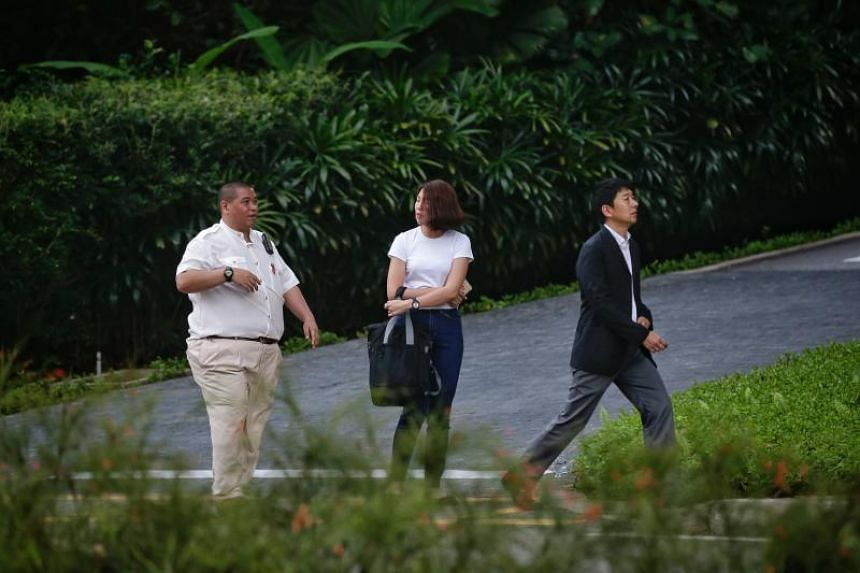 A Capella Hotel staff member diverts a couple away from the entrance of a road that leads to the hotel on May 30, 2018.