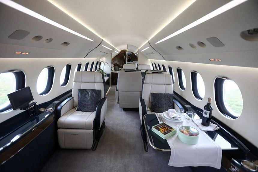 The interior of a Falcon 7X business jet.