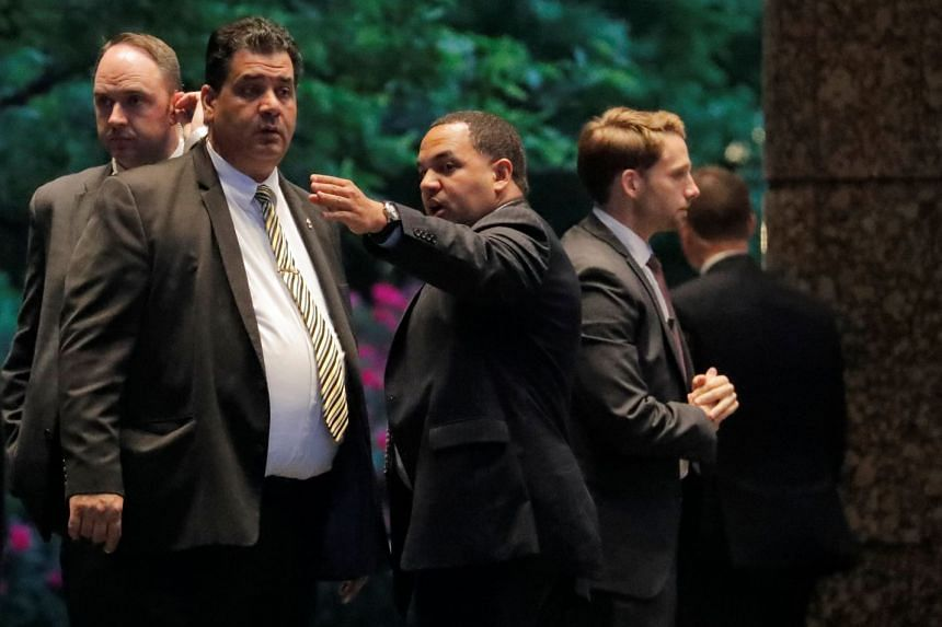 A Secret Service agent gestures outside of the entrance where North Korean envoy Kim Yong Chol and US Secretary of State Mike Pompeo met in New York, US, on May 30, 2018.