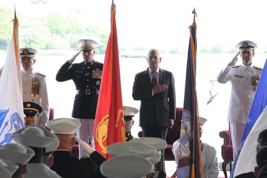 US Pacific Command head Admiral Harry Harris (left); General Joe Dunford, Chairman of the Joint Chiefs of Staff (second left); US Defense Secretary Jim Mattis and Admiral John Richardson (right) attend a change of command ceremony in Pearl Harbor, Ha