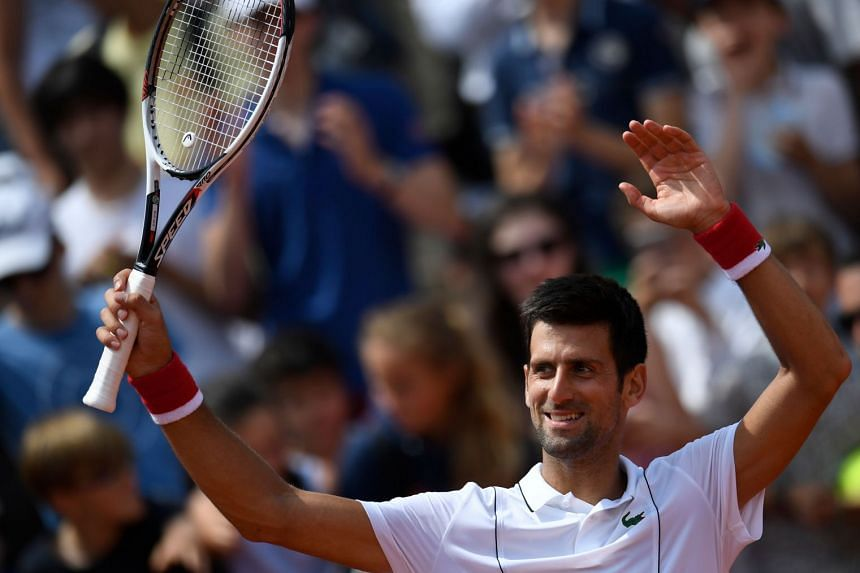 A happy Serb Novak Djokovic after a tough victory over Spain's Jaume Munar in their second-round match on day four of The Roland Garros 2018 French Open tennis tournament in Paris on May 30, 2018.