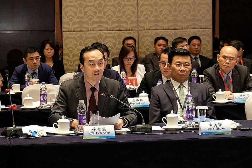 Senior Minister for State for Trade and Industry Koh Poh Koon speaking at the Singapore-Nanjing Special Projects Cooperation Panel in Nanjing yesterday. Next to him is Mr Lee Yi Shyan, a member of the Singapore delegation. Dr Koh witnessed the signin