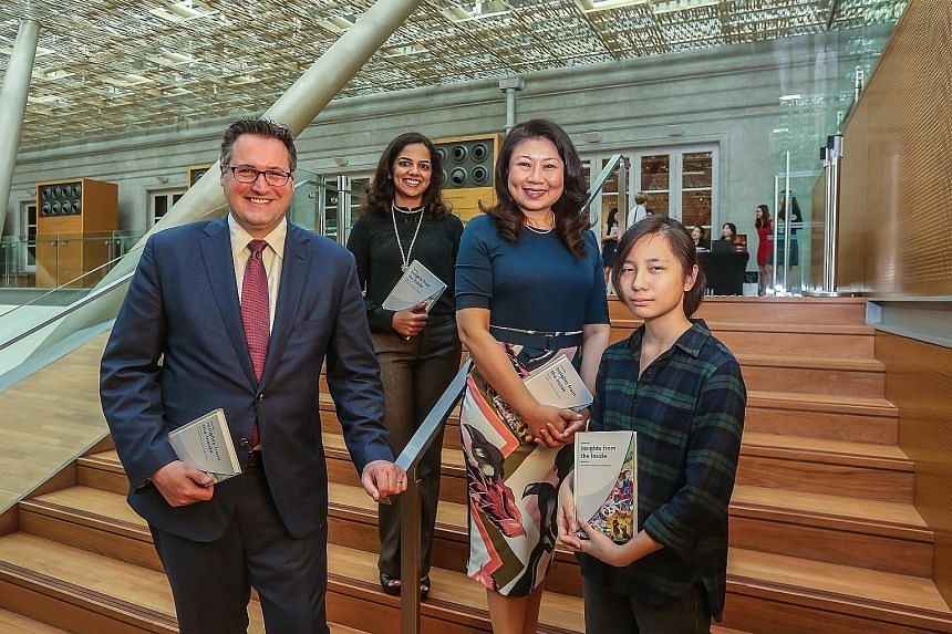 Contributors to Singapore: Insights From The Inside (from left) Matthew Herrmann, Divya Patel and Chong Siak Ching with Ms Amelia Tan, one of the illustrators for the book, at the National Gallery Singapore on Wednesday.