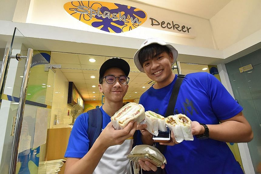 The Splash n Decker outlet (far left) in Ngee Ann Polytechnic was bustling with customers yesterday. Among those who bought sandwiches were students Jarrell Chua (left, with spectacles) and Justin Khoo. Today is the 25-year-old campus eatery's last d