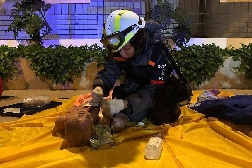 """Once the """"casualties"""" were cleared of contaminants during the exercise at Compass One shopping mall, SCDF officers provided medical assistance at the on-site first aid point."""