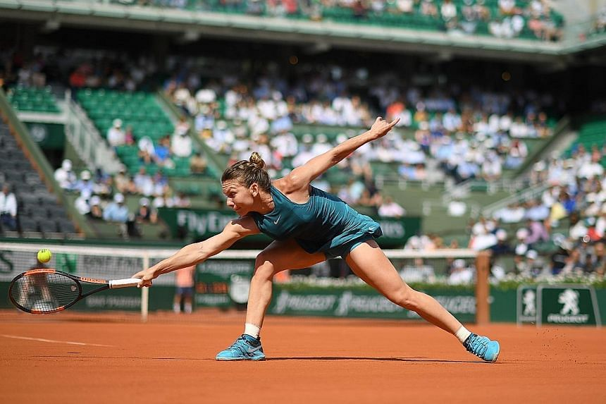 Romania's Simona Halep at full stretch for a backhand during her 6-3, 6-1 win against a determined Taylor Townsend of the United States in Paris yesterday.