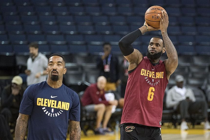 Cleveland Cavaliers forward LeBron James shooting the ball next to guard J.R. Smith during NBA Finals media day at Oracle Arena. Despite being 33, James will be his team's key player against the Golden State Warriors.