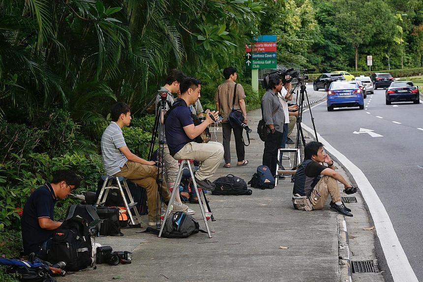 Foreign media personnel, mostly from Japan, staking out a road leading to the Capella Hotel on Sentosa on Wednesday, where the American delegation has been staying. At least 2,000 media personnel are expected to cover the proposed Trump-Kim summit.