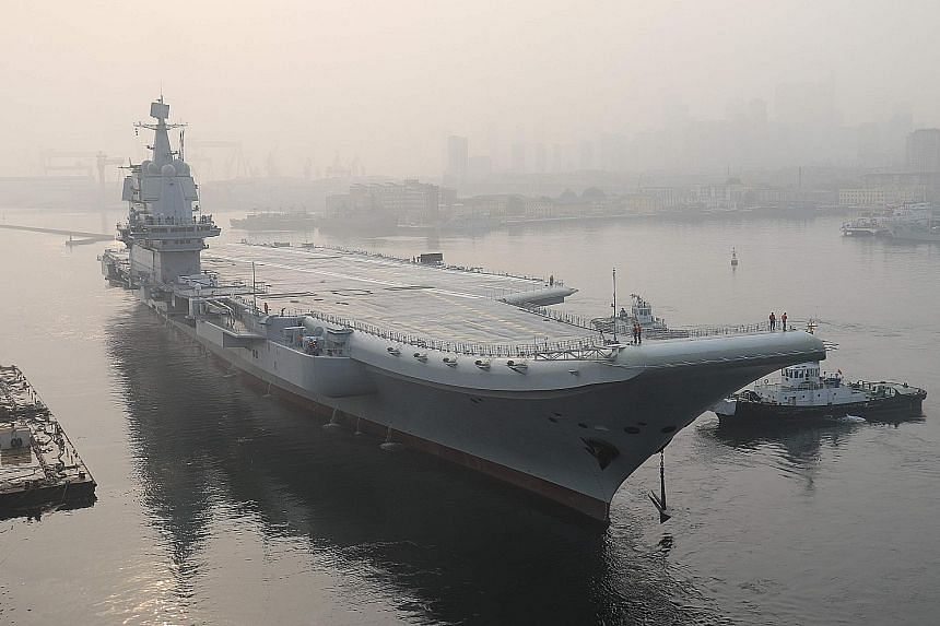 China's first domestically manufactured aircraft carrier, as yet unnamed, started sea trials last month.