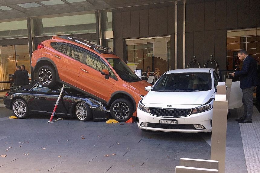 The accident occurred near the Hyatt Regency Sydney yesterday. The valet was trying to park the Porsche when, instead of reversing, the car reportedly accelerated into the back of the Subaru SUV and ended up under it instead.