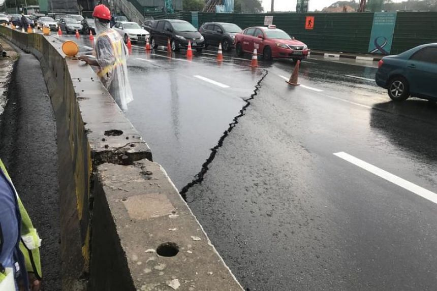 The cracks, which appeared right next to a huge excavation to build an underpass which will be part of the Bukit Brown road, were caused by water pressure that had built up because of heavy rain.