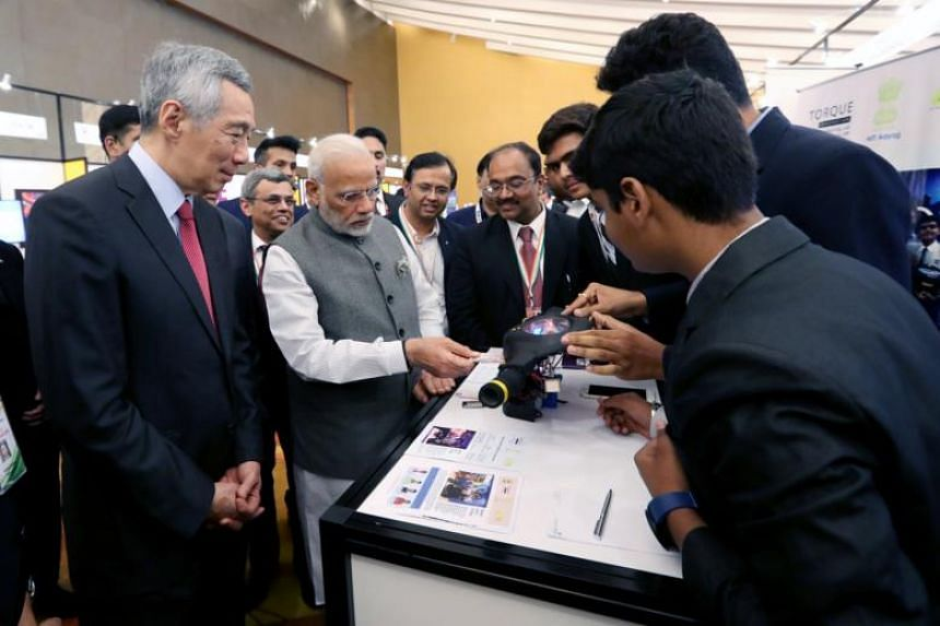 Prime Minister Lee Hsien Loong and visiting Indian Prime Minister Narendra Modi, at the Enterprise and Innovation exhibition on May 31, 2018.